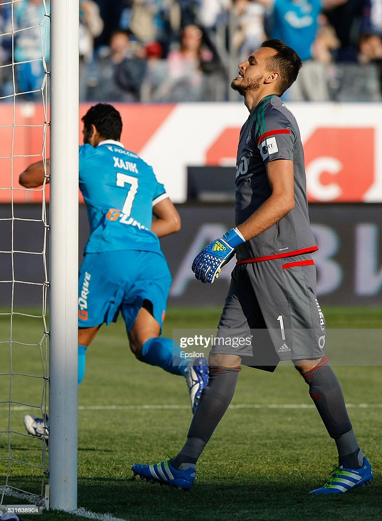 Marinato Guilherme (R) of FC Lokomotiv Moscow reacts as <a gi-track='captionPersonalityLinkClicked' href=/galleries/search?phrase=Hulk+-+Soccer+Player&family=editorial&specificpeople=7359350 ng-click='$event.stopPropagation()'>Hulk</a> of FC Zenit St. Petersburg celebrates his goal during the Russian Football League match between FC Zenit St. Petersburg and FC Lokomotiv Moscow at Petrovsky stadium on May 15, 2016 in St. Peterburg, Russia.
