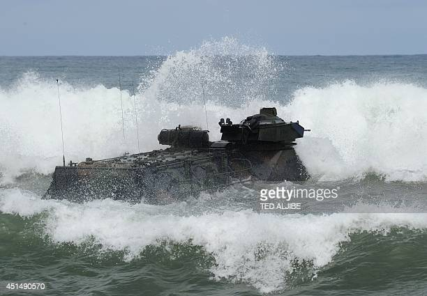 Marine amphibious assault vehicle maneouvers in rough seas during a mock beach assault with their Philippine counterparts as part of Cooperation...