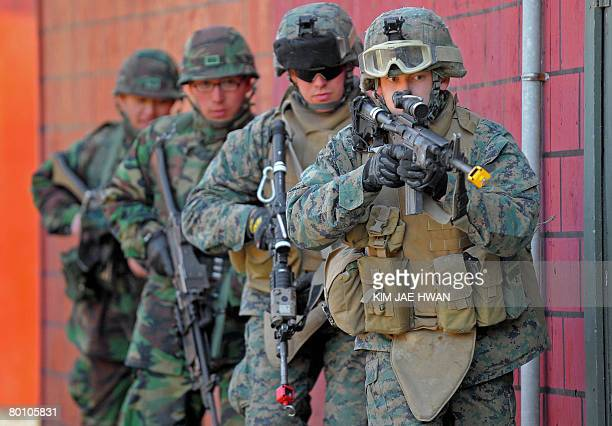 US Marine and South Korean Marine soldiers move into position during the CQB drill at the US army's Rodriguez range in Pocheon about 70 km northeast...