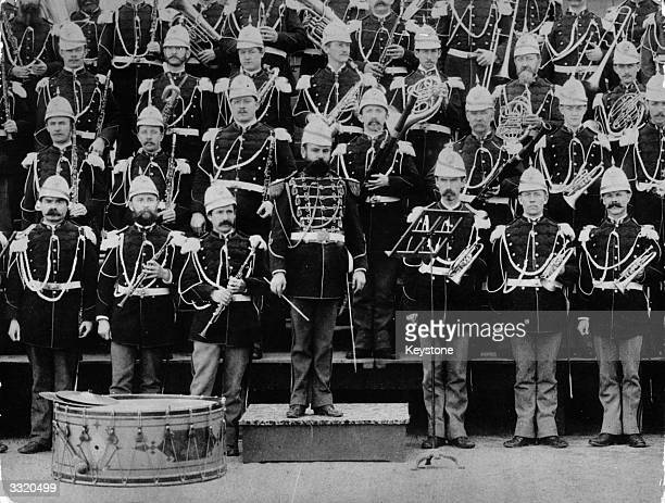Marine Band in uniform with gold braid epaulets and beehive helmets Their conductor is John Philip Sousa who wrote 'The Stars and Stripes Forever' as...