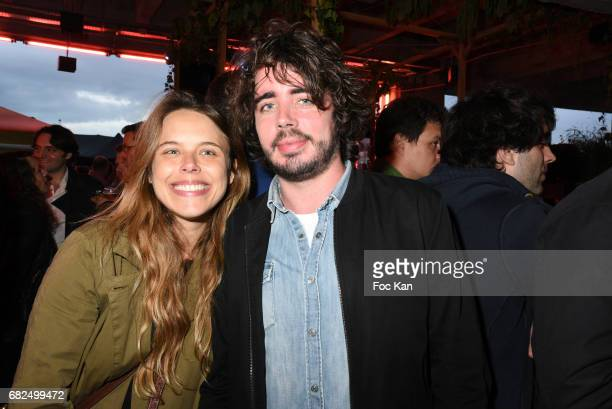 Marine Bidaud from the Fooding and comedian Eric Metzger attend Foodstock 10th Anniversary Concert Party at Grand Rivage on May 12 2017 in Paris...