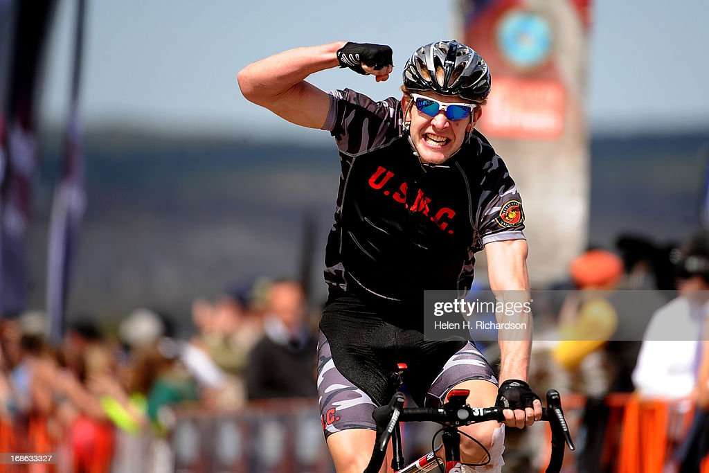 Marine Brian McPherson pumps his fist in the air after wining the Men's 30K Bicycle Open race in 47:20. The fourth annual Warrior Games cycling event took started and finished at Falcon Stadium on the grounds of the Air Force Academy in Colorado Springs, CO on May 12, 2013. HRH Prince Harry was on hand to start the race as well as to hand out medals at the finish line. A total of 260 wounded, ill and injured service members and veterans came to compete in the week long games. Members of the Army, Marine Corps, Navy/Coast Guard/Air Force. Special Operations and the British Armed Forces all took part in the competition. Other events included in the Warrior Games are shooting, sitting volleyball, track & field and wheelchair basketball.