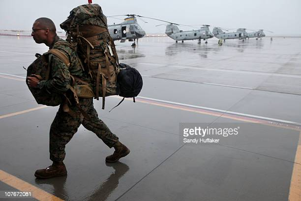 A marine carries his belongings after arriving home from a seven month deployment December 17 2010 at Miramar Marine Corp Air Station in San Diego...