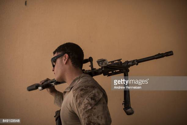 S marine carries his weapon at Camp Bost on September 11 2017 in Helmand Province Afghanistan About 300 marines are currently deployed in Helmand...