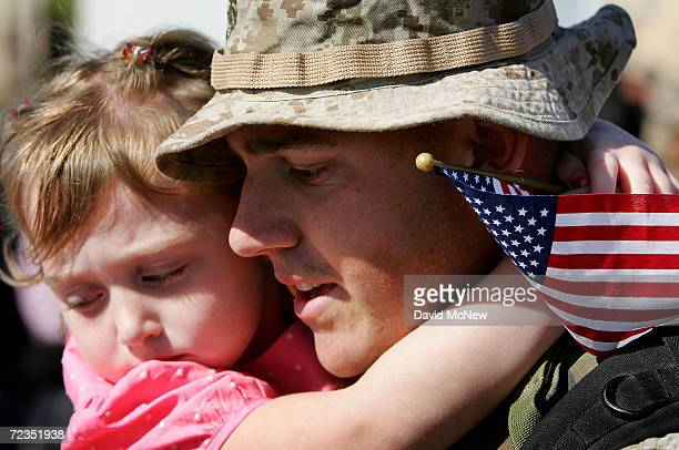 S Marine Corp Dan Ferrari holds his fouryearold daughter Alexis as he returns home from Iraq with the Marines from the Marine Expeditionary Force...