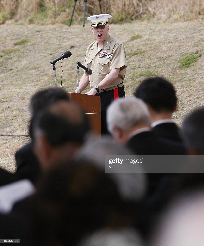 US Marine Corp Lt. Gen. John M. Paxton delivers a eulogy during a memorial service jointly held by Japan and the United States to mark the anniversary of one of World War II's bloodiest and most symbolic battles on the remote island of Iwo Jima, which is now officially called Ioto in Japan, 700 miles (1,100 kilometers) south of Tokyo on March 13, 2013. AFP PHOTO / POOL / Takeshi Ogura JAPAN OUT