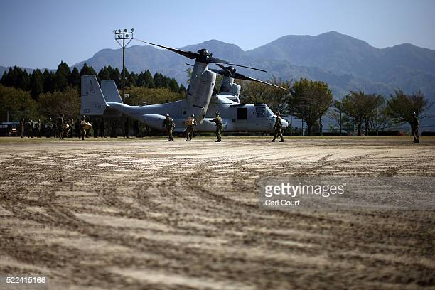 Marine Corp Osprey delivering relief supplies is unloaded by Japan SelfDefense Forces following an earthquake on April 19 2016 in Minamiaso near...