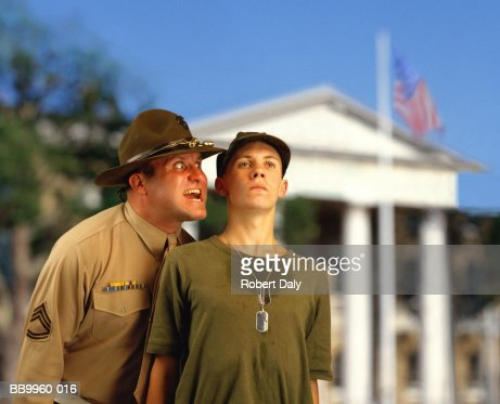 US Marine Corp sergeant shouting at new recruit (Digital Composite) : Stock Photo