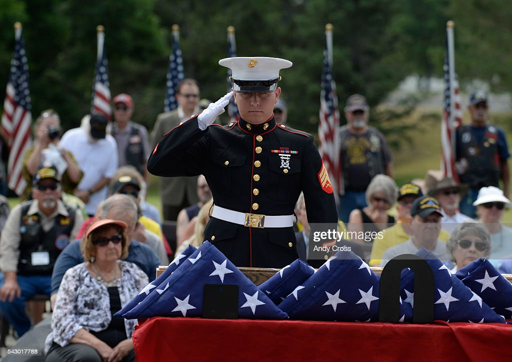 Marine Corp Sgt. Caleb Stowers salutes cremated remains of military veterans at Ft. Logan June 25, 2016. The Missing in America Project interned the unclaimed remains of 30 WWII, Korea, and Vietnam Veterans at the Ft. Logan National Cemetery in a ceremony that included a speeches, roll call of the deceased, gun salute, taps, and an F-16 fly over.