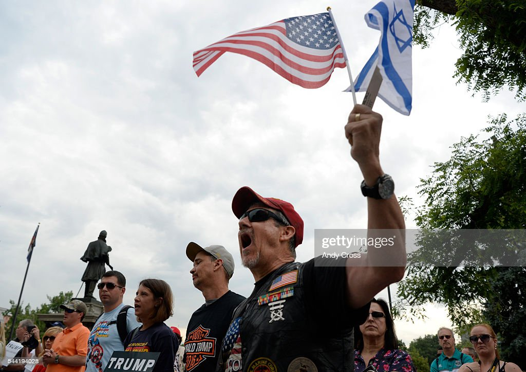 Marine Corp Veteran Jonathan Rash shows his support during a pro-Donald Trump rally on the west steps of the Colorado State Capitol July 01, 2016. The GOP Presidential Candidate was in town for the Western Conservative Summit.
