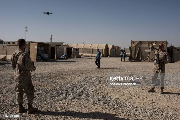 S Marine Corporal Isaac Brown from Virginia operates a surveillance drone which provides base security on September 10 2017 at Camp Shorab in Helmand...
