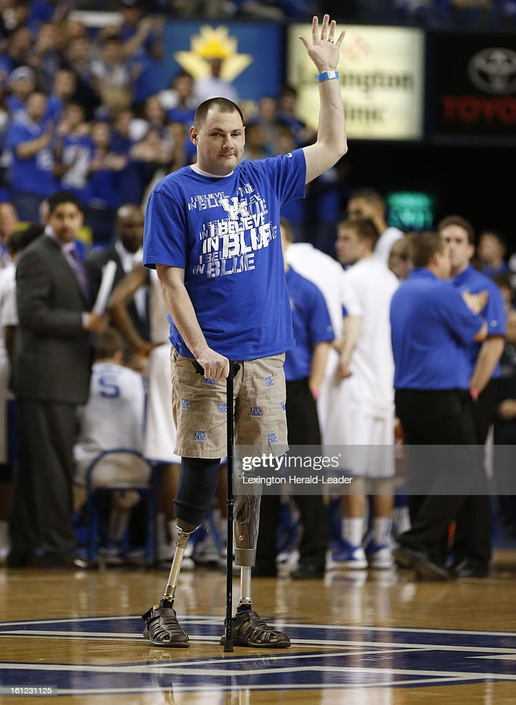 Marine Corporal Matthew Bradford, who lost both legs and his eyesight due to a roadside bomb, waves to the crowd as he is recognized during a time out as Kentucky played Auburn at Rupp Arena on Saturday, February 9, 2013, in Lexington, Kentucky.