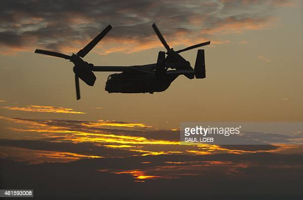 Marine Corps Bell Boeing MV22 Osprey helicopter is seen in flight at sunset in this aerial photograph near Washington DC January 15 in support of a...