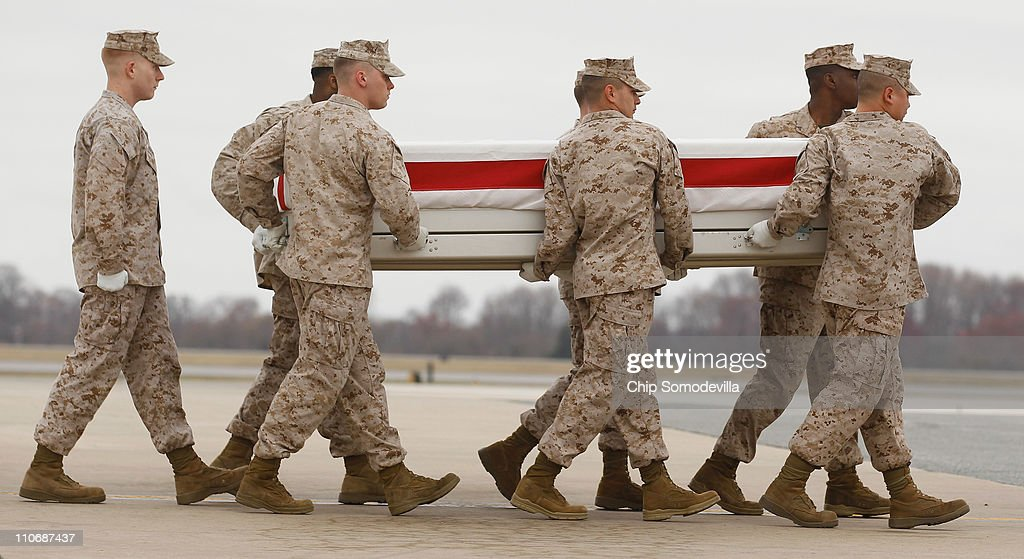 S. Marine Corps carry team moves the flag-draped transfer case with the remains of Marine Staff Sgt. James Malachowski across the tarmac at Dover Air Force Base March 23, 2011 in Dover, Deleware. A platoon sergeant with the 3rd Platoon, Fox Company, 2nd Battalion, 8th Marine Regiment, 2nd Marine Division, II Marine Expeditionary Force, Malachowski of Westminster, Maryland, was on his fourth combat deployment when he was killed in action March 20 in Afghanistan.