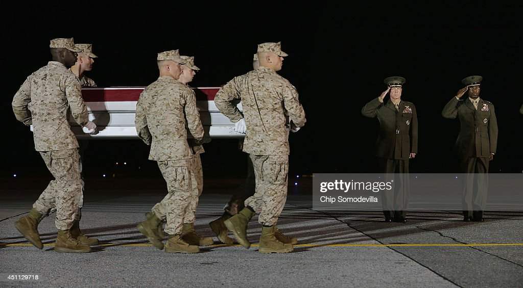 Marine Corps Commandant Gen. James Amos (2nd R) and Deputy Commandant Lt. Gen. Ronald Bailey salute as a U.S. Marine Corps carry team transfers the remains of Lance Cpl. Adam Wolff of Cedar Rapids, Iowa, from an C-17 aircraft to a transfer vehicle at Dover Air Force Base June 23, 2014 in Dover, Delaware. Members of the 2nd Combat Engineer Battalion, 2nd Marine Division, II Marine Expeditionary Force at Camp Lejeune, Wolff; Lance Cpl. Brandon Garabrant of Peterborough, NH; and Staff Sgt. David Stewart of Stafford, Virginia were killed Friday when their vehicle was struck by a roadside bomb in Helmand province in southern Afghanistan.