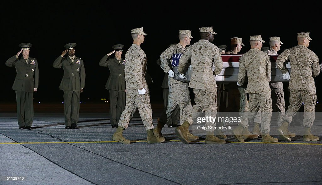 Marine Corps Commandant Gen. James Amos, Deputy Commandant Lt. Gen. Ronald Bailey and Deputy Commandant Lt. Gen. William Faulkner salute as a U.S. Marine Corps carry team transfers the remains of Lance Cpl. Adam Wolff of Cedar Rapids, Iowa, from an C-17 aircraft to a transfer vehicle at Dover Air Force Base June 23, 2014 in Dover, Delaware. Members of the 2nd Combat Engineer Battalion, 2nd Marine Division, II Marine Expeditionary Force at Camp Lejeune, Wolff; Lance Cpl. Brandon Garabrant of Peterborough, NH; and Staff Sgt. David Stewart of Stafford, Virginia were killed Friday when their vehicle was struck by a roadside bomb in Helmand province in southern Afghanistan.
