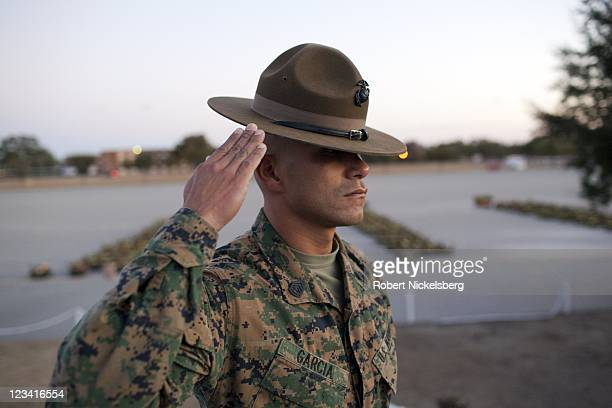 Marine Corps Drill Instructor salutes during a dawn ceremony for new Marines after a 9mile hike ending the 54hour Crucible exercise January 8 2011 at...