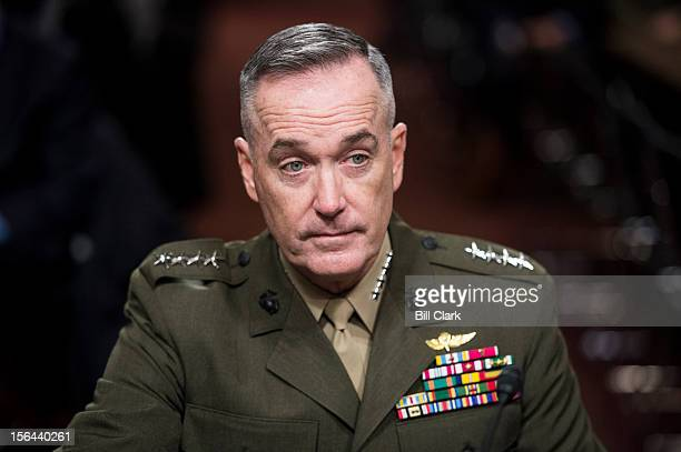 Marine Corps Gen Joseph Dunford Jr prepares to testify during his Senate Armed Services Committee confirmation hearing on his nomination for...