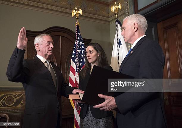 Marine Corps General James Mattis is swornin as Defense Secretary by Vice President Mike Pence in the Vice Presidential ceremonial office in the...