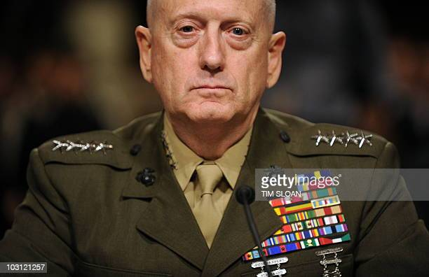 US Marine Corps General James Mattis waits to testify before the Senate Armed Service Committee for his reappointment to the grade of general and to...