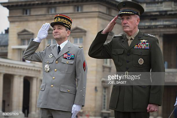 US Marine Corps General Joseph Dunford and French Army Chief of Staff General Pierre De Villiers attend a ceremony at the Paris Military School...