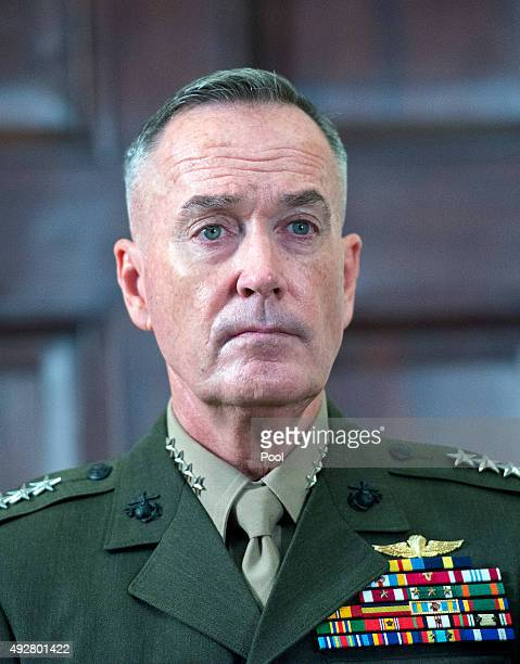S Marine Corps General Joseph F Dunford Chairman of the Joint Chiefs of Staff looks on US President Barack Obama speaks about Afghanistan troop...