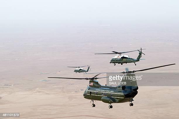 US Marine Corps helicopters escort US President Barack Obama to Rawdat Khurayim Saudi King Abdullah's desert camp 60 KM northeast of Riyadh on March...