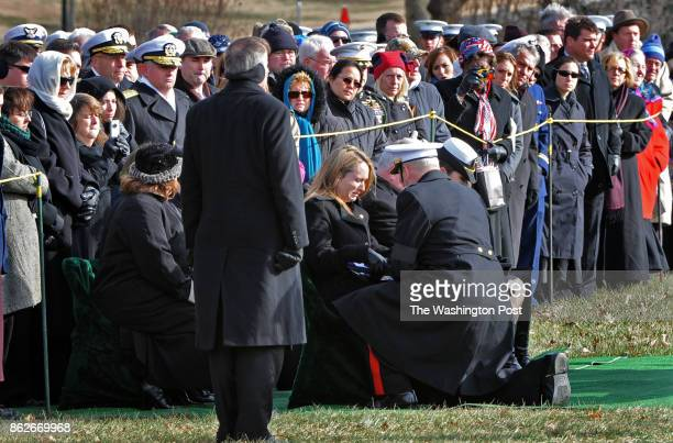 ARLINGTON VA DECEMBER 14 2010 Marine Corps Lt Gen John F Kelly presents the flag to Linsey Donnelly widow at graveside services are held for her...