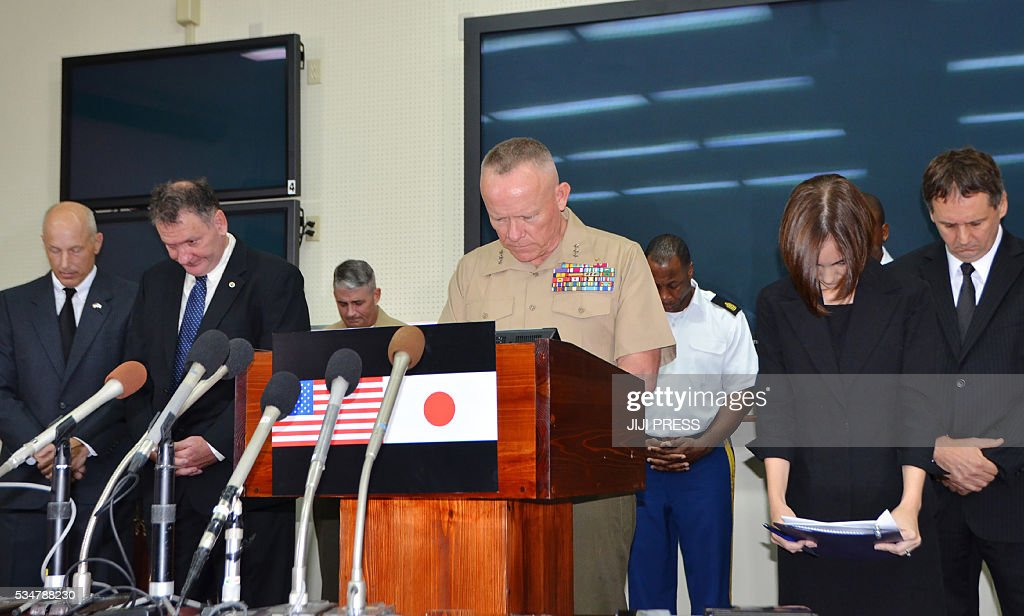 US Marine Corps Lt. Gen. Lawrence D. Nicholson (C), the Okinawa Area Cooordinator and Commanding General of III Marine Expeditionary Force Commander, offers a silent prayer for a murdered Japanese woman during a press conference at Camp Foster in Okinawa on May 28, 2016. Okinawan police arrested US citizen and former US Marine Kenneth Franklin Shinzato on May 19 for allegedly disposing of a woman's body in a weed-covered area in southern Okinawa. / AFP / JIJI PRESS / JIJI PRESS / Japan OUT
