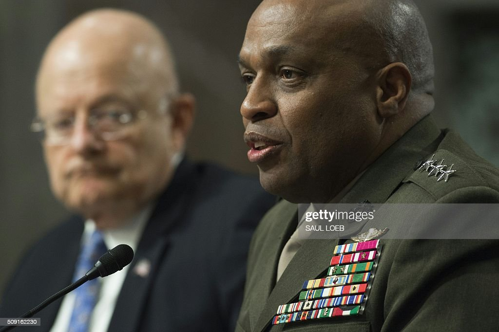 Marine Corps Lt. Gen. Vincent Stewart (R), director of the Defense Intelligence Agency, and James Clapper (L), director of National Intelligence, testify during a Senate Armed Services Committee hearing on Capitol Hill in Washington, DC, February 9, 2016. The global threat posed by the Islamic State group is still rising but US-based homegrown extremists pose the biggest danger to the homeland, Washington's top spy said February 9. In a report prepared for US lawmakers before he was due to address a Senate panel, Director of National Intelligence James Clapper said US-based extremists pose 'the most significant Sunni terrorist threat.' / AFP / Saul LOEB
