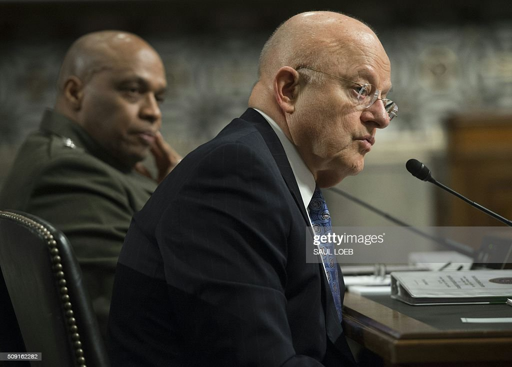 Marine Corps Lt. Gen. Vincent Stewart (L), director of the Defense Intelligence Agency, and James Clapper (R), director of National Intelligence, testify during a Senate Armed Services Committee hearing on Capitol Hill in Washington, DC, February 9, 2016. The global threat posed by the Islamic State group is still rising but US-based homegrown extremists pose the biggest danger to the homeland, Washington's top spy said February 9. In a report prepared for US lawmakers before he was due to address a Senate panel, Director of National Intelligence James Clapper said US-based extremists pose 'the most significant Sunni terrorist threat.' / AFP / Saul LOEB