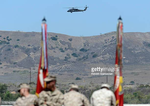 S Marine Corps military helicopter passes as members of USMC wait for the arrival of US President Barack Obama to deliver remarks during his visit at...