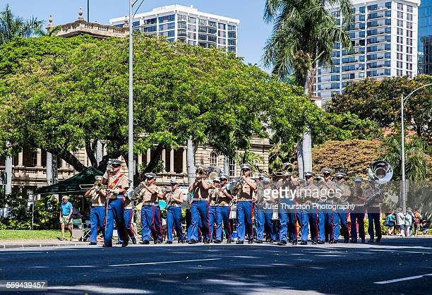 US Marine Corps Pacific Fleet Band in military uniform marching and playing in the local downtown annual King Kamehameha Day Parade in Honolulu...