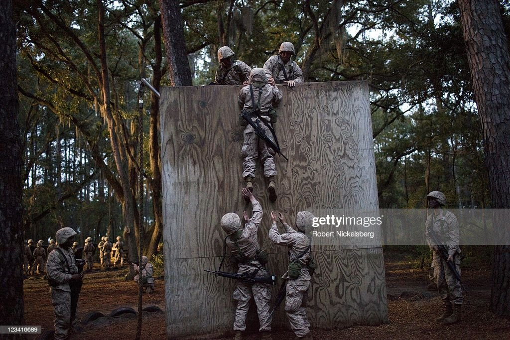 Marine Corps recruits perform a team work drill during the 54hour Crucible exercise January 6 2011 at the Marine Corps Recruit Depot on Parris Island...