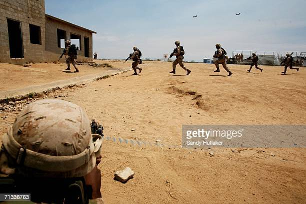 S Marine Corps reservists with the 1st Battalion 24th Marine Regiment engage in a live training drill at a mock urban village June 29 2006 at Camp...