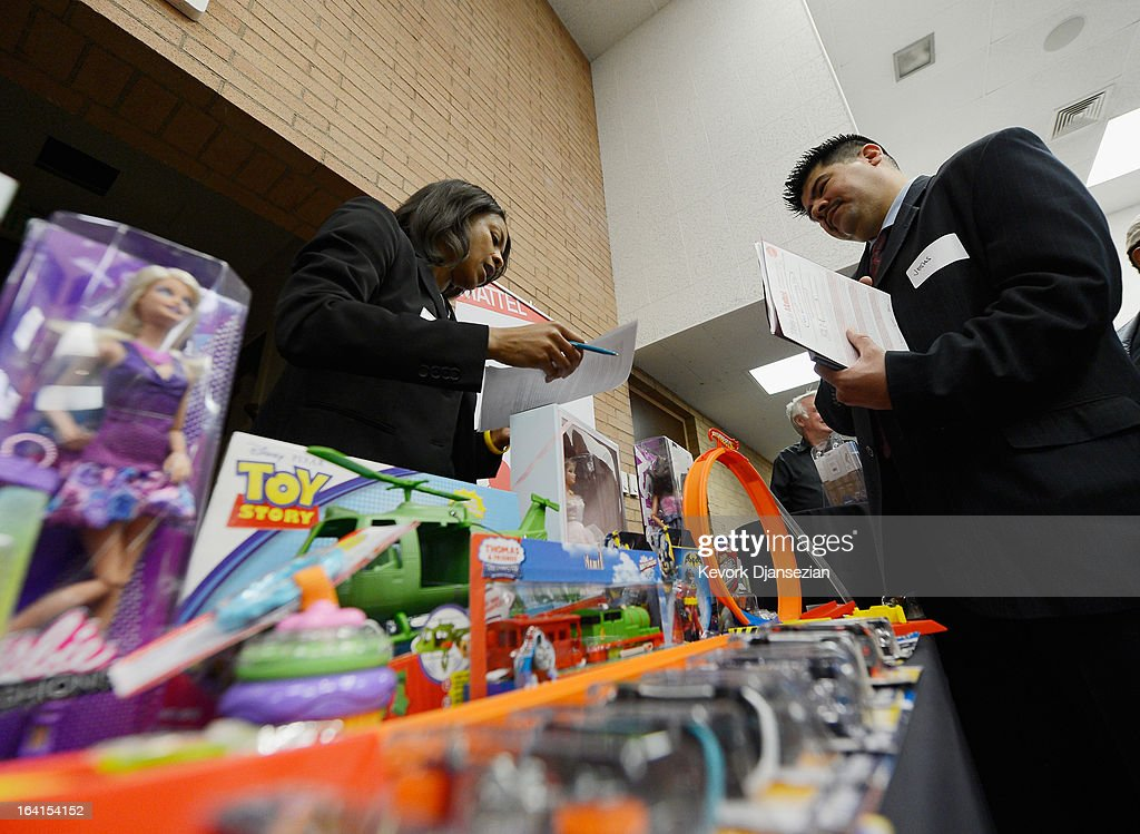 U.S. Marine Corps veteran Jesus Guzman (R) listens to Via Van Liew from Mattel toys during a jobs fair for veterans called 'Serving Those Who Have Served' on the campus of University of Southern California on March 20, 2013 in Los Angeles, California. California's unemployment rate tied with Rhode Island's for highest in U.S. at 9.8 percent.