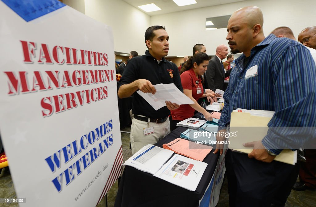U.S. Marine Corps veteran Jose Navarrete (R) listens to Brian Mendez with University of Southern California facilities management services as he looks for employment during a jobs fair for veterans called 'Serving Those Who Have Served' on campus on March 20, 2013 in Los Angeles, California. California's unemployment rate tied with Rhode Island's for highest in U.S. at 9.8 percent.