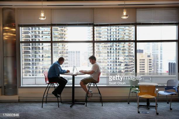 S Marine Corps veteran Ricardo Aguilar gets help with his resume from Google employee Mark Oakey on June 11 2013 in Chicago Illinois The two were...