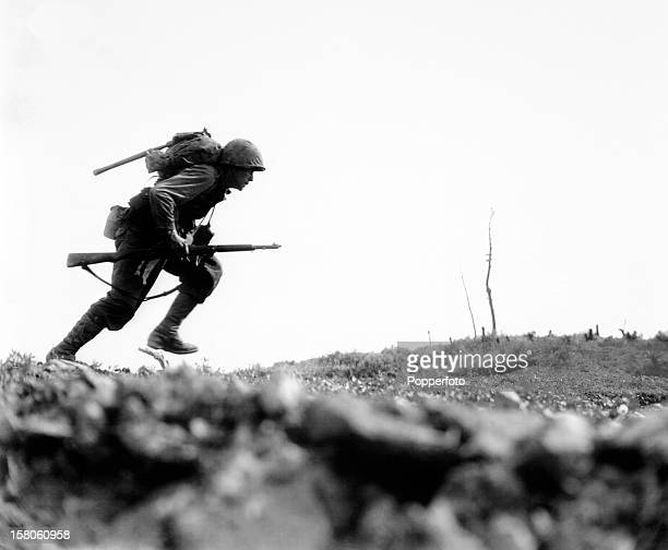 Marine dashes through Japanese machine gun fire crossing Death Valley on Okinawa during World War Two on 10th May 1945 This image is from the files...
