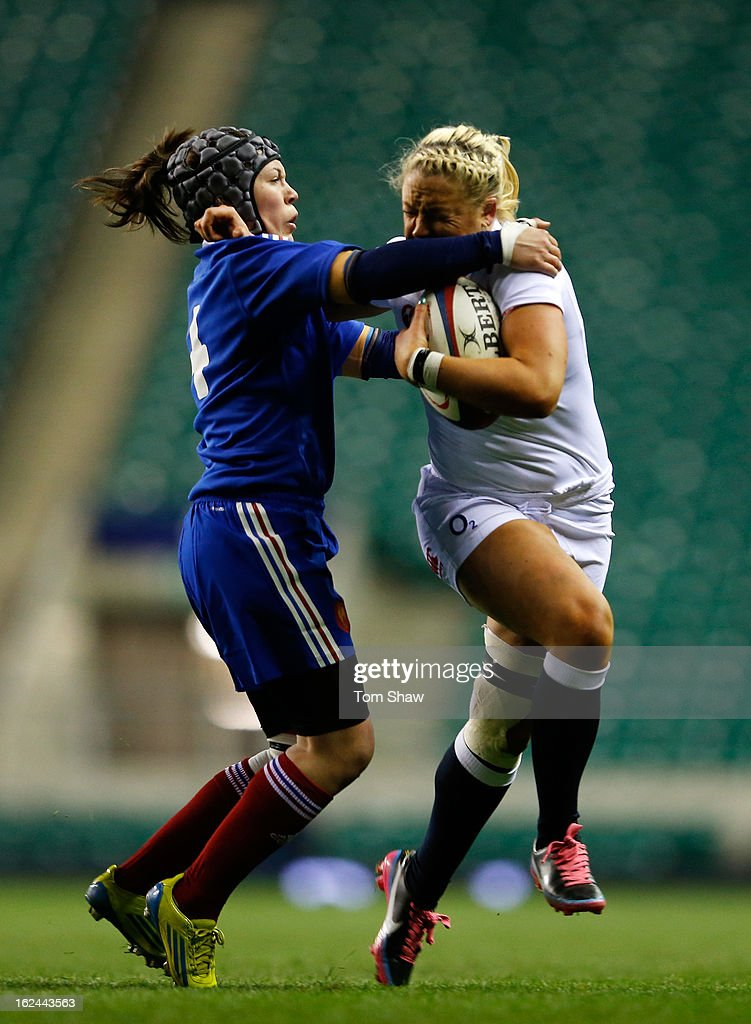 Marine De Nadai of France tackles Sally Tuson of England during the Women's RBS Six Nations match between England and France at Twickenham Stadium on February 23, 2013 in London, England.