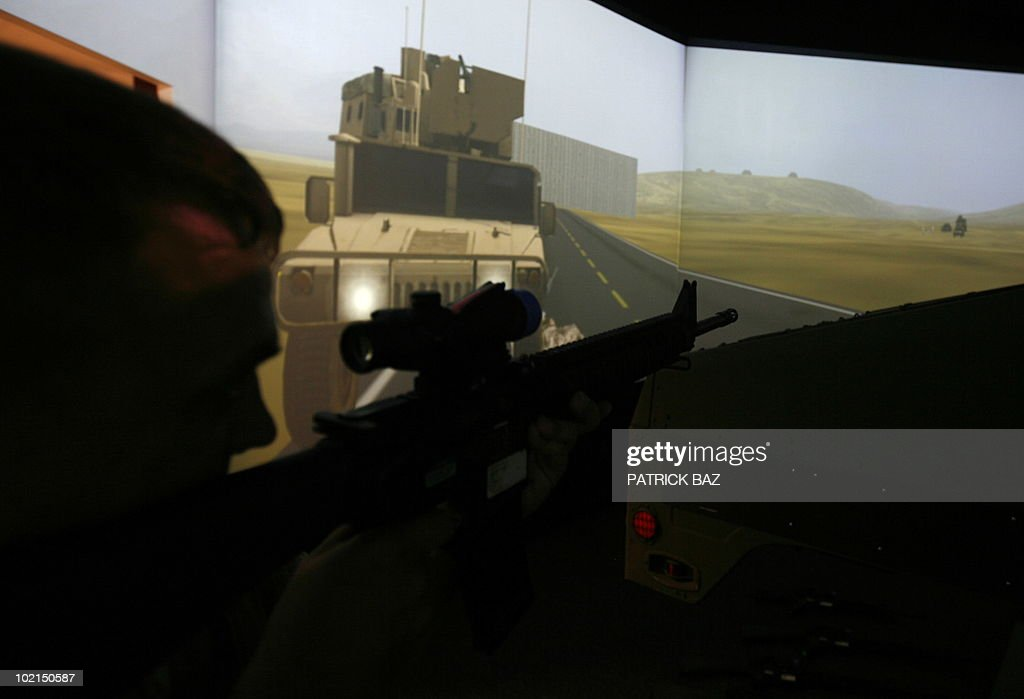 A US marine demonstrates the use of a Convoy Combat Simulator at the US marine base in Oahu, Hawaii on June 16, 2010. Marines are trained on combat simulators before their deployment to Afghanistan.