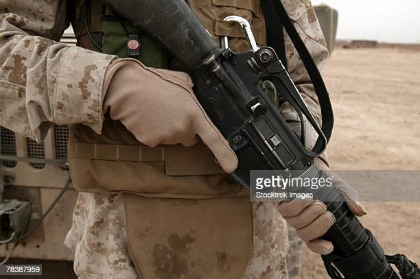 A Marine displays protective equipment.