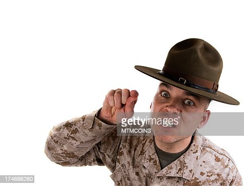 Marine drill instructor pointing forward wearing a brown hat