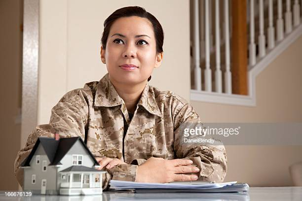 US Marine Female Soldier Holding a  Small House
