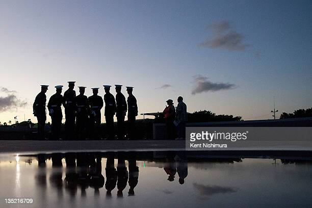 S Marine firing detail prepares for a memorial service for the 70th anniversary of the attack on the US naval base at Pearl Harbor on the island of...