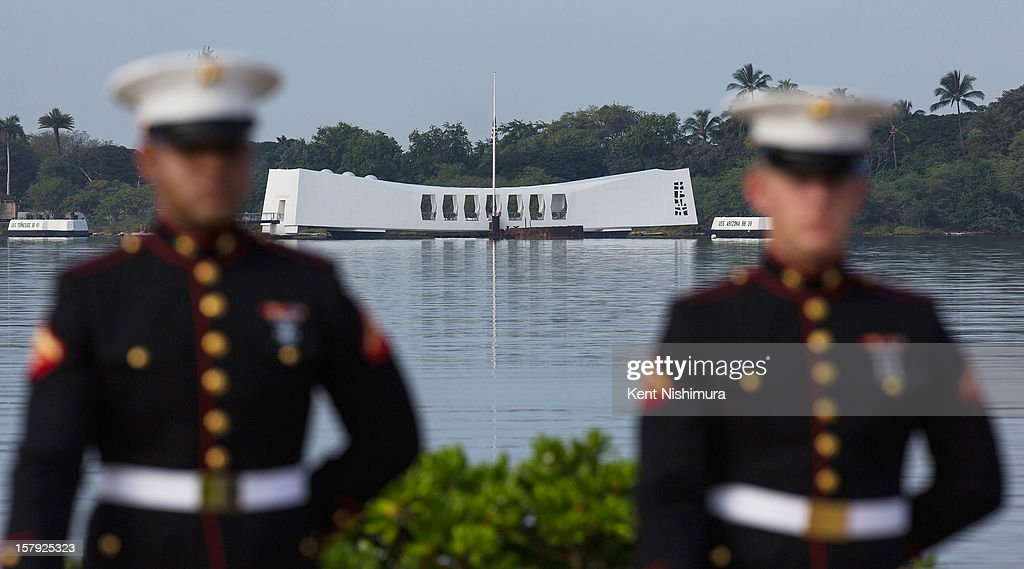 S. Marine firing detail stands at attention with the Arizona Memorial in background during the 71st Annual Memorial Ceremony commemorating the WWII Attack On Pearl Harbor at the World War 2 Valor in the Pacific National Monument December 7, 2012 in Pearl Harbor, Hawaii. This is the 71st anniversary of the Japanese attack on Pearl Harbor.