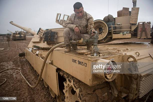 Marine from 1 Marines division 1 Tanks Delta company 3 platoon refuels his M1 Abrams tank at FOB Edinburgh base Helmand province on February 2 2011...
