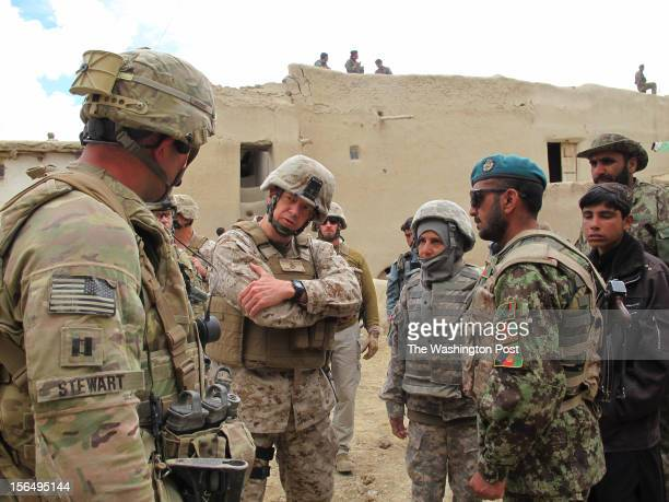 S Marine Gen John R Allen the supreme allied commander in Afghanistan center talks to US Army Capt Michael Stewart commander of Able Company of the...