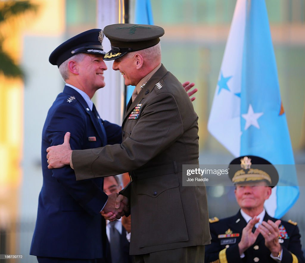 U.S. Marine General John F. Kelly (R) embraces the outgoing commander U.S. Air Force General Douglas Fraser as U.S. Army General Martin Dempsey, Chairman, Joint Chiefs of Staff looks on during a change of command ceremony at United States Southern Command on November 19, 2012 in Doral, Florida. U.S. Marine Gen. John Kelly takes over the command from U.S. Air Force Gen. Douglas Fraser.