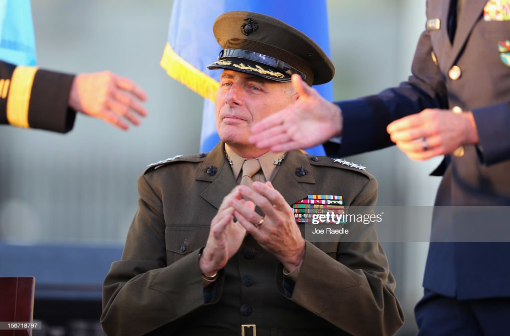 U.S. Marine General John F. Kelly (C) looks on as U.S Army General Martin E. Dempsey, Chairman, Joint Chiefs of Staff, (L) shakes hands with the outgoing commander U.S. Air Force Genberal Douglas Fraser during a change of command ceremony at United States Southern Command on November 19, 2012 in Doral, Florida. U.S. Marine Gen. John Kelly takes over the command from U.S. Air Force Gen. Douglas Fraser.